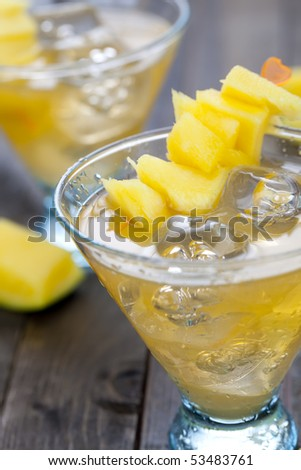 Close up of mango drink with pieces of fruits