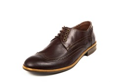 Close up of mans classic brown leather shoes isolated on white background