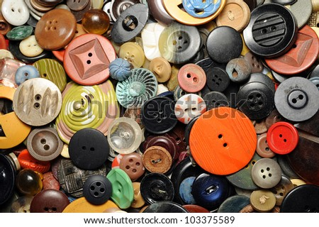 Close-up of many colorful buttons in a collection