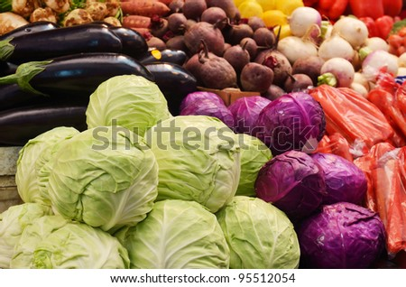 close up of many colorful vegetables on market stand