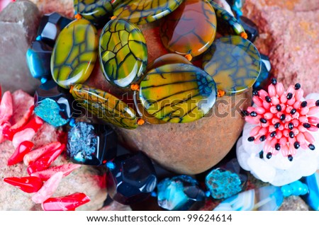 Close up of many different colorful natural gems: agate onyx, coral