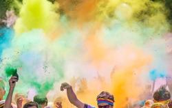 Close-up of marathon, people covered with colored powder.