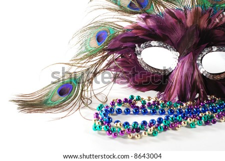 close-up of Mardi Gras mask and beads