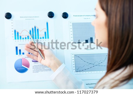 Close-up of marketing analysis presented by female - stock photo