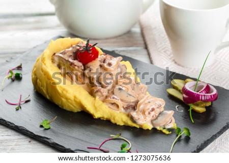 Close up of mashed potatoes with mushroom gravy #1273075636