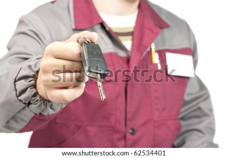 Close-up of mechanic giving a car key. Isolated on white