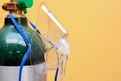 Close-up of Medical Oxygen Tank with Mask Hanging from Side