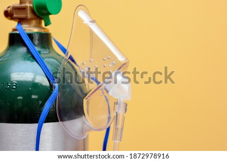 Close-up of Medical Oxygen Tank with Mask Hanging from Side Stok fotoğraf ©
