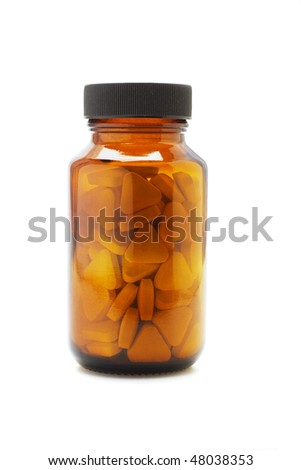 close up of medicine bottle with triangular shape tablets inside on white