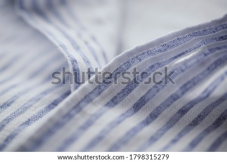 Photo of  Close up of mens striped shirt.