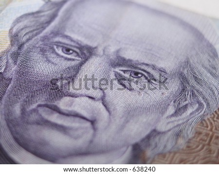 Close Up of mexican thousand peso currency showing the face of the independence leader Miguel Hidalgo. This are new Bills.