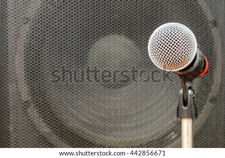 Close up of microphone in concert hall or conference room. Music equipment in training room.