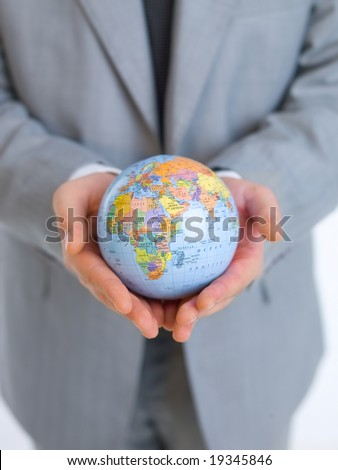 Close up of middle aged business man holding globe model