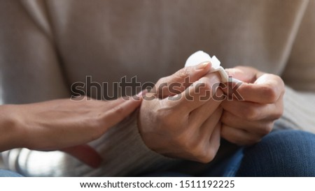 Close up of middle-aged 60 woman hold paper tissue feel stressed depressed melancholic for loss, caring daughter comfort caress sad senior mother show empathy and love, elderly healthcare concept