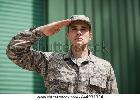 Close-up of military soldier giving salute in boot camp