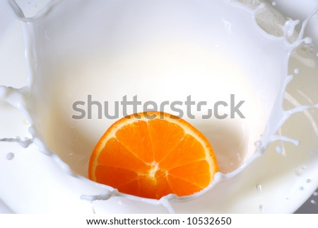 Close up of milk splash with orange