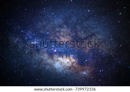 Stock Photo Close up of Milky way galaxy with stars and space dust in the universe, Long exposure photograph, with grain.