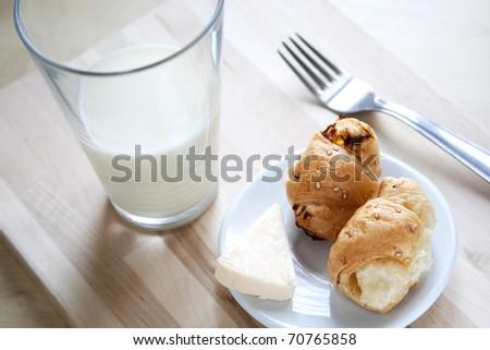 close-up of mini croissant  and milk