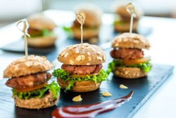 Close up of mini hamburgers at catering event.