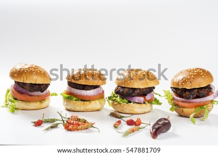 Close up of mini hamburgers with peppers. mini hamburgers, sliders. Fresh mini burger meal - Shutterstock ID 547881709