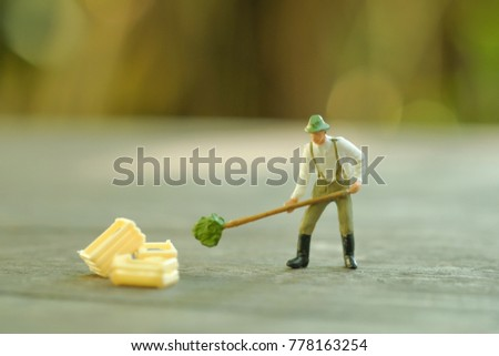 Close up of Miniature farmer people, Elegant Design with copy space for placement your text, mock up for farmer and gradening concept