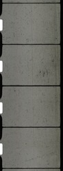 close up of 8mm movie filmstrip isolated on white background, old scratched homemovie film material.