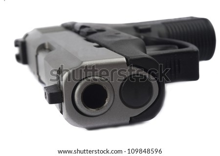 Close up of 9mm pistol isolated on white background