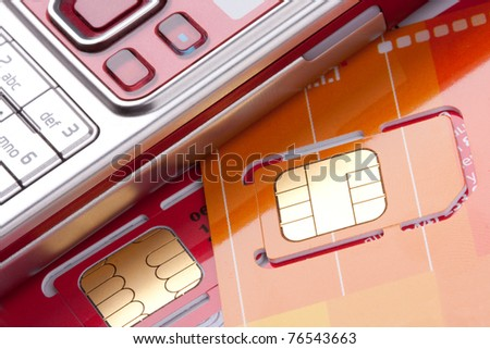 Close-up of mobile phone with sim cards