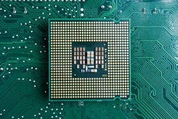 Close-up of modern CPU Chip Processor for tech science background. Selective Focus.