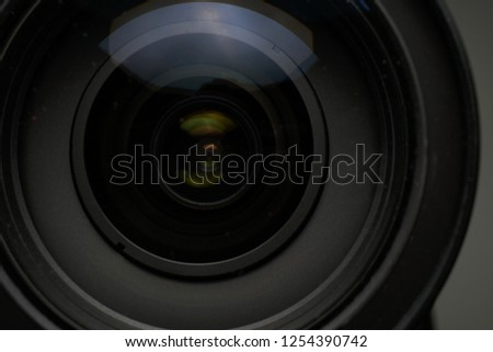 Close up of modern digital camera lense, a view of the front lens with flare effects #1254390742