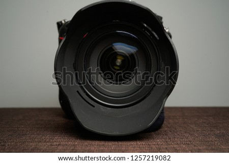 Close up of modern digital camera lense, a view of the front lens with flare effects #1257219082