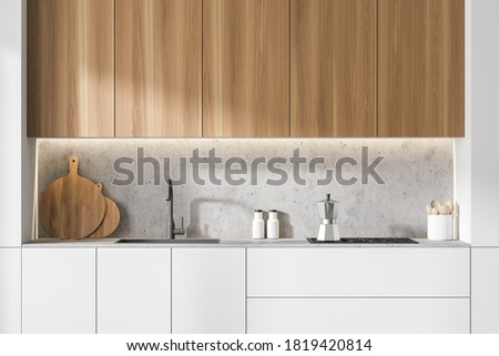 Close up of modern kitchen with white and wooden walls, concrete floor, white and wooden cupboards. 3d rendering Stock photo ©