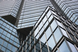 close up of modern skyscraper / abstract building background / glass reflection