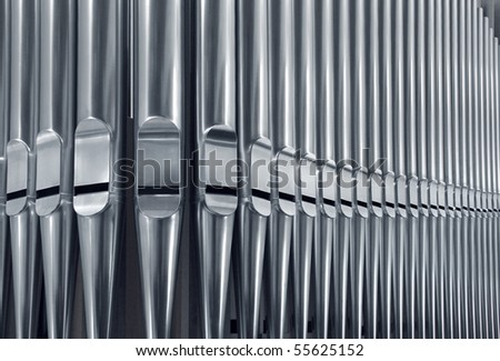 Close-up of modern steel organ pipe set horizontal