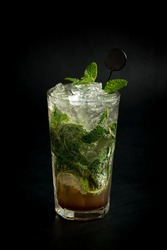 Close up of mojito on black background.