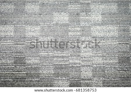 Close up of monochrome grey carpet texture background.