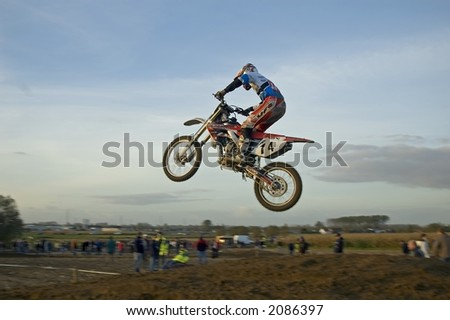 close up of motorcrosser jumping