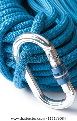 Close up of mountaineering equipment with a blue plaited polyester climbing rope with an aluminium screw gate karabiner