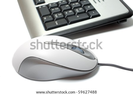 Close up of mouse and keyboard isolated on white background.