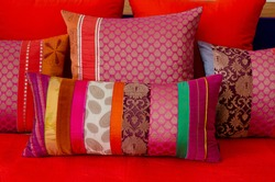 Close-Up Of Multi Colored Cushions On Sofa At Home