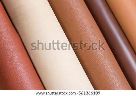 Close up of multicolored rolls of leather. High resolution photo,