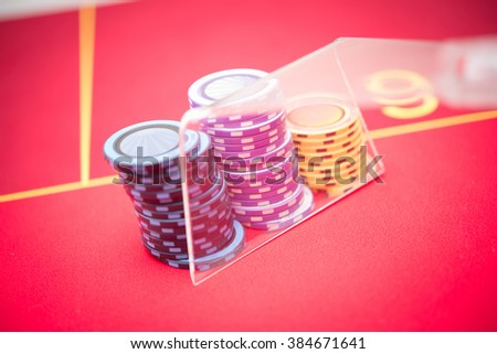 Close-up of multicoloured gambling chips on poker table. #384671641