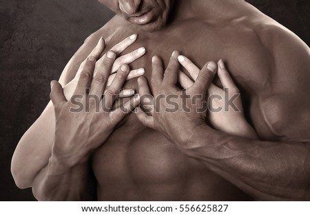 Free photos Close-up of muscular male arms and body. Holding female ...