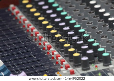 Close up of Music Mixing Table With Colour Buttons and Knobs #1464952022