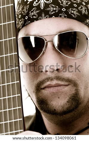 Close-up of musician and his guitar. face and strings color processed