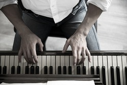 Close up of musician hands classic piano playing