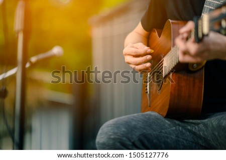 Close-up of musicians, guitarists playing blues at outdoor concerts, musical concept.
