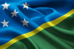Close up of national flag of Solomon Island waving in the wind