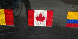Close-up of national flags of Canada and two other countries made from mosaic tiles, Korean War Memorial, Battery Park, New York City, New York State, USA