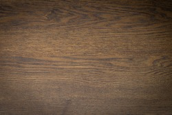 Close-up of Natural dark brown wood texture background with vignette. Abstract old surface rough pattern. Design in your work backdrop and decoration. Concept blank copy space for text.